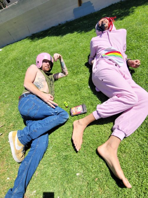 Jon Boi Hansen, left, laid out, high, next to Zaine Jakeem after smoking a fusion of Broccoli Brands and Heavy Grass cannabis spliffs and joints.